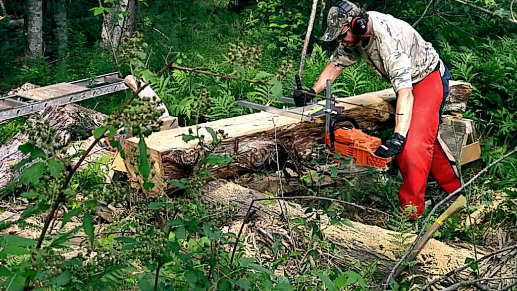 Granberg Chainsaw Mill and Echo CS 590 Timber Wolf working on a reclaimed ceder log. Photo by A.J. Kilpatrick